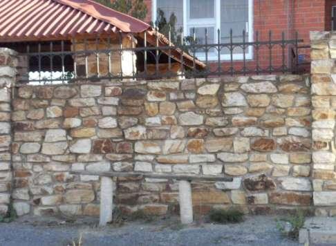 Каменные заборы. Строительство забора из камня своими руками